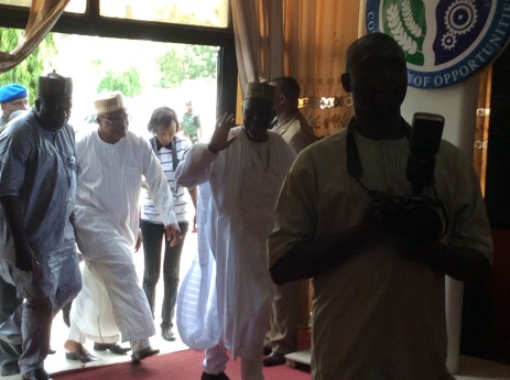 His Excellency, the governor of Kogi state, waving, Captain Idris Wada, being ushered into the glass house, venue of the launch by the HCH, Dr Idris Omede (23rd April, 2015)